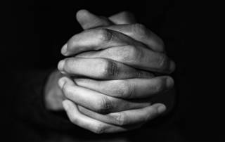 Hands folded in faith